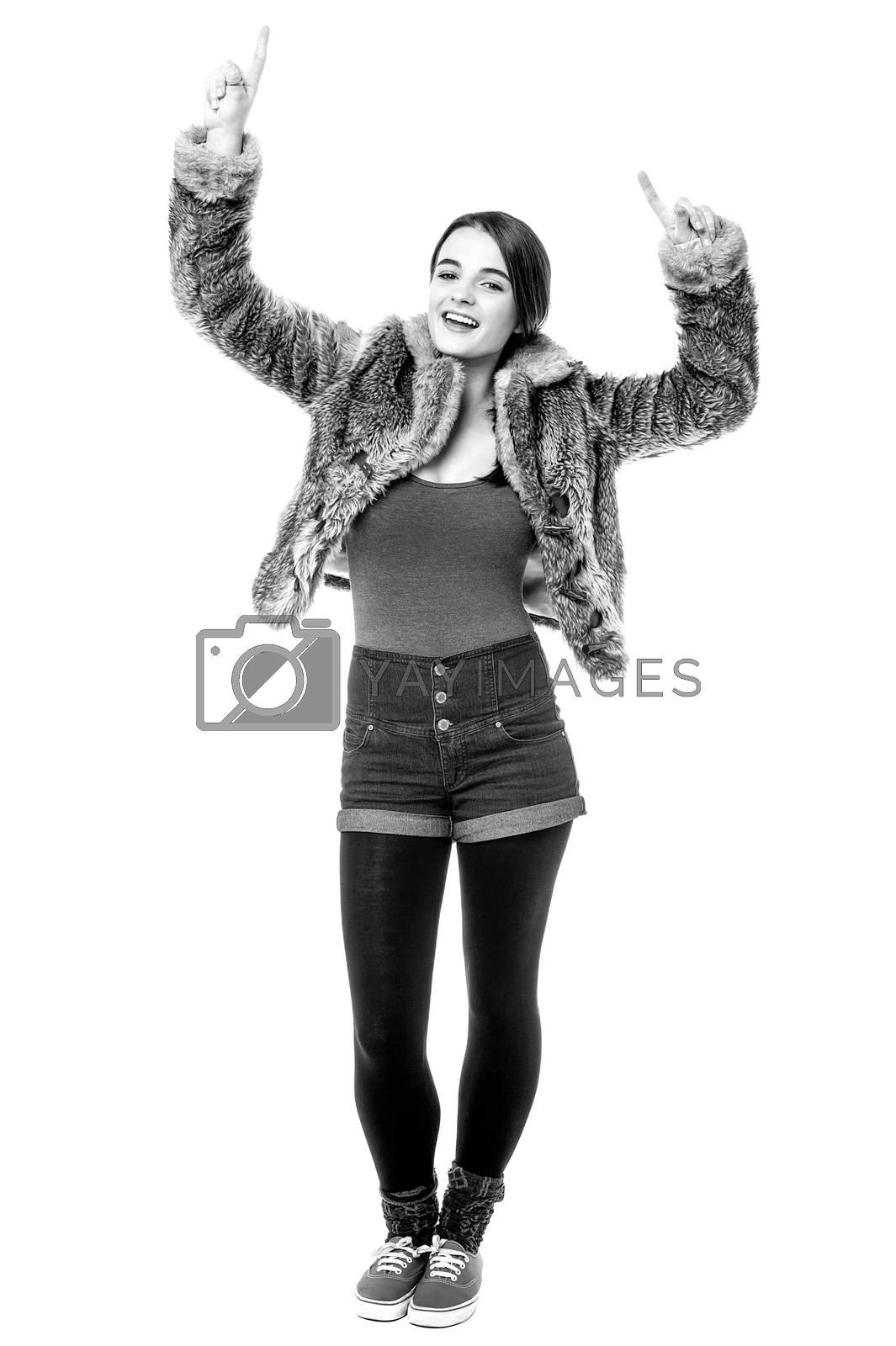 Full length image of teen girl dancing