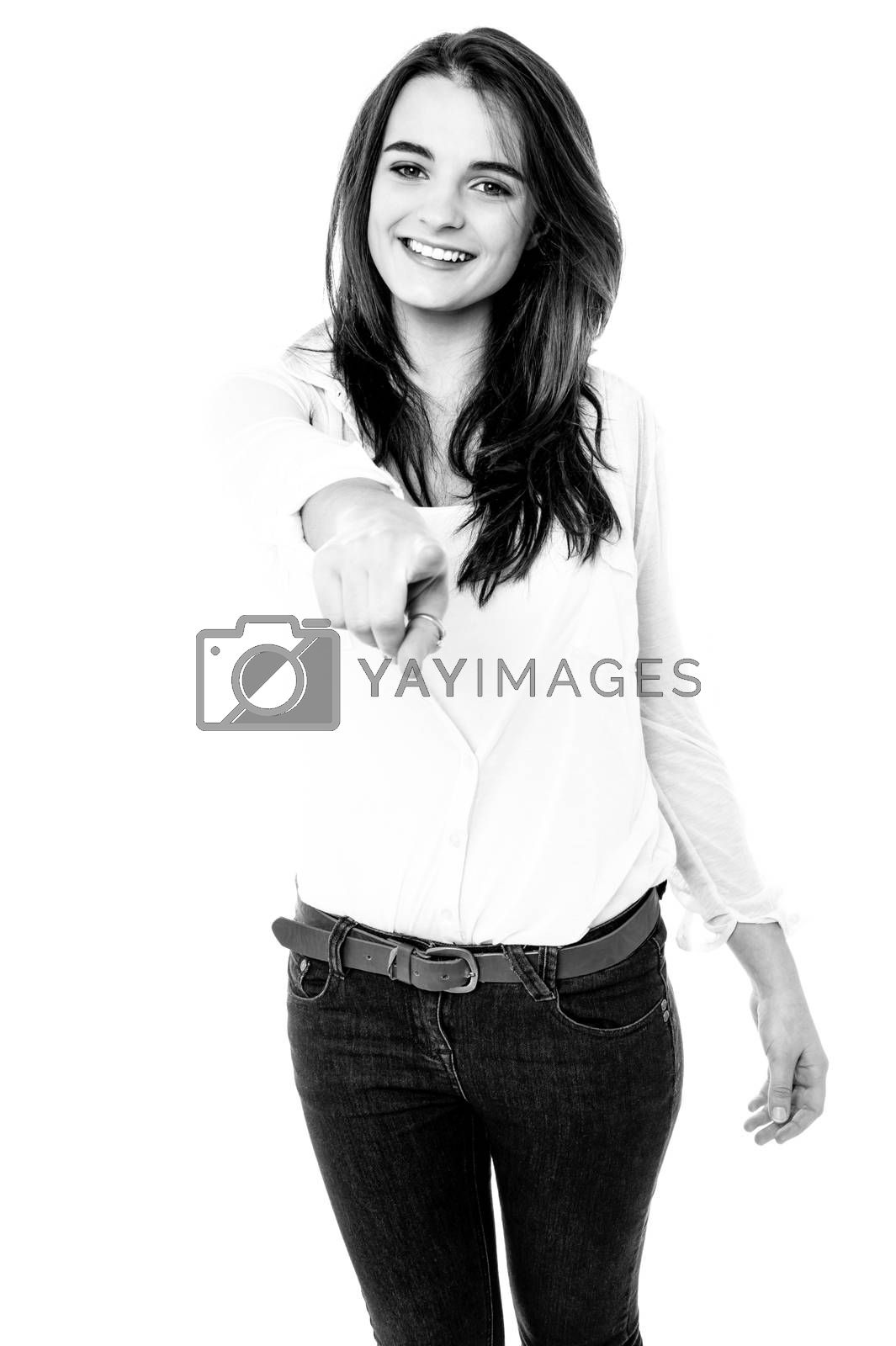 Black and white image of a girl pointing her finger