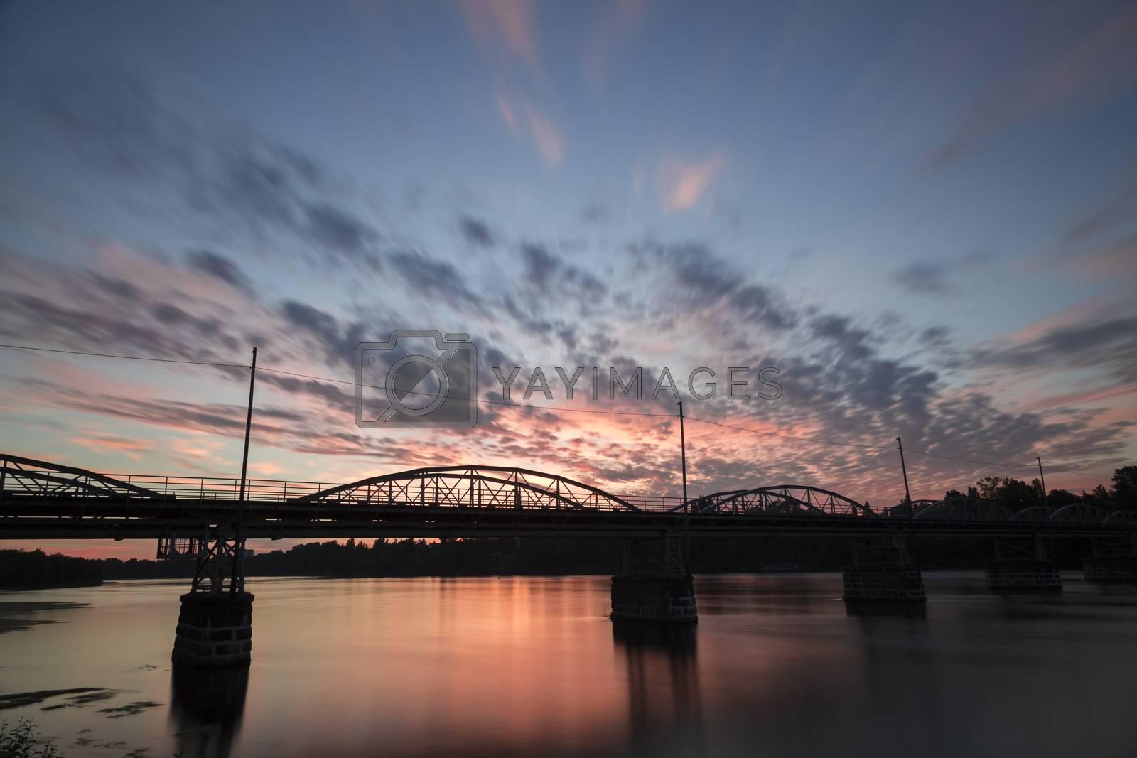 "Bridge over the Umeå, River in Sweden at sunset. This is the ""Old Bridge"" (Gamla Bron)."