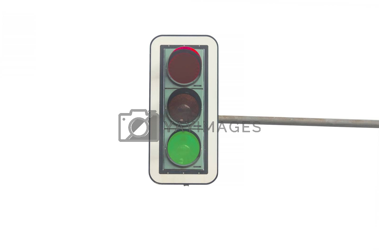 Green color on the traffic light in front of a white background. Symbolizing the beginning and start free ride.