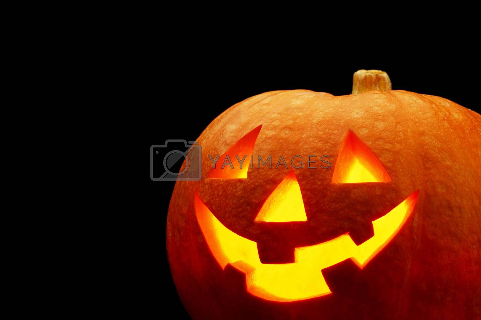 Glowing Halloween pumpkin isolated on black background