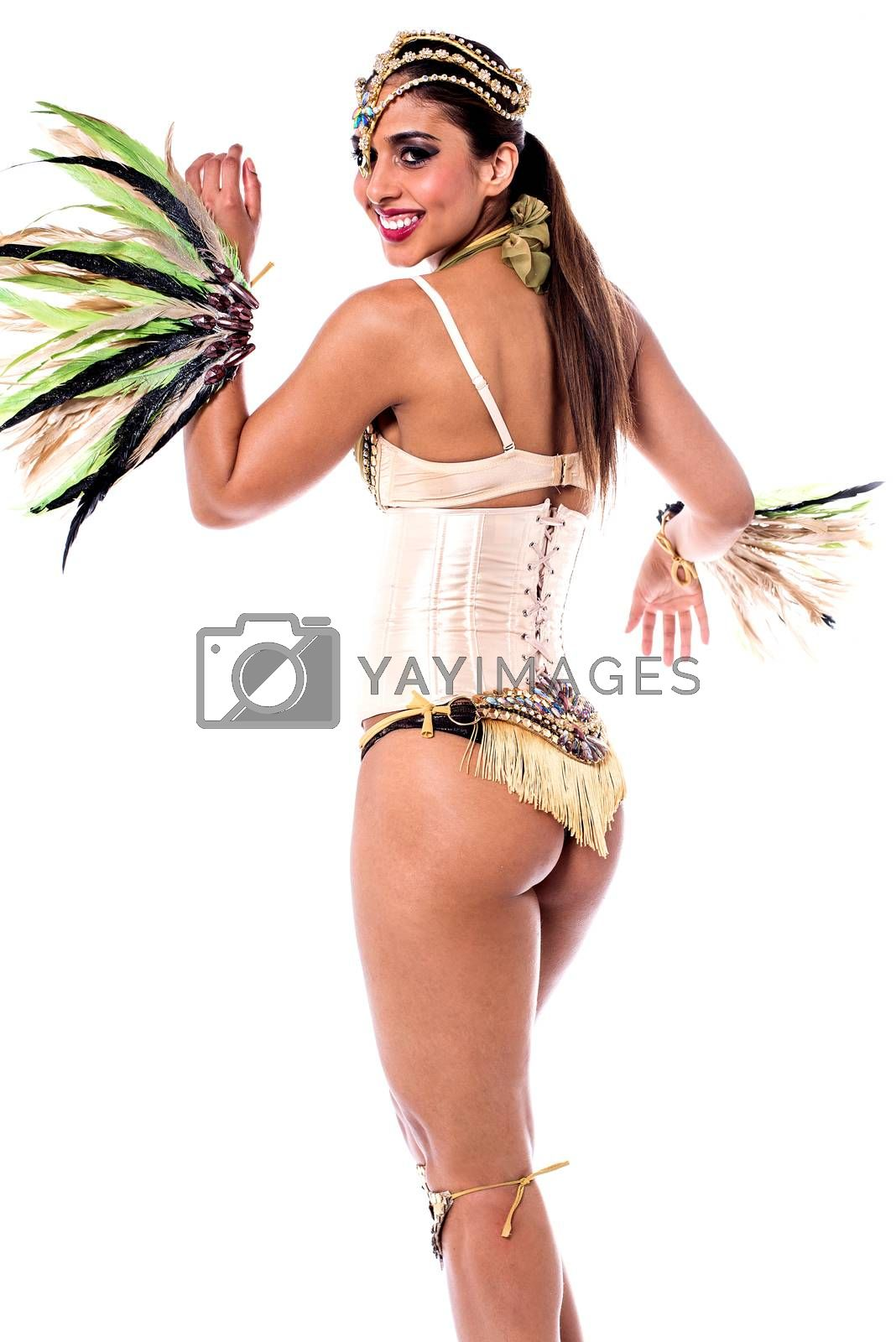Pretty samba dancer woman looking back over white