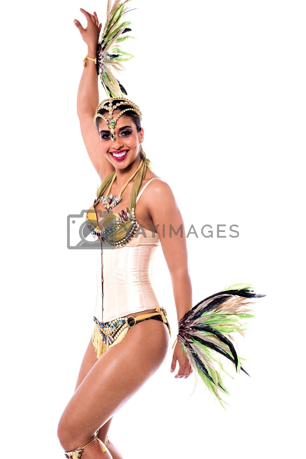 Beautiful woman posing in carnival costume over white