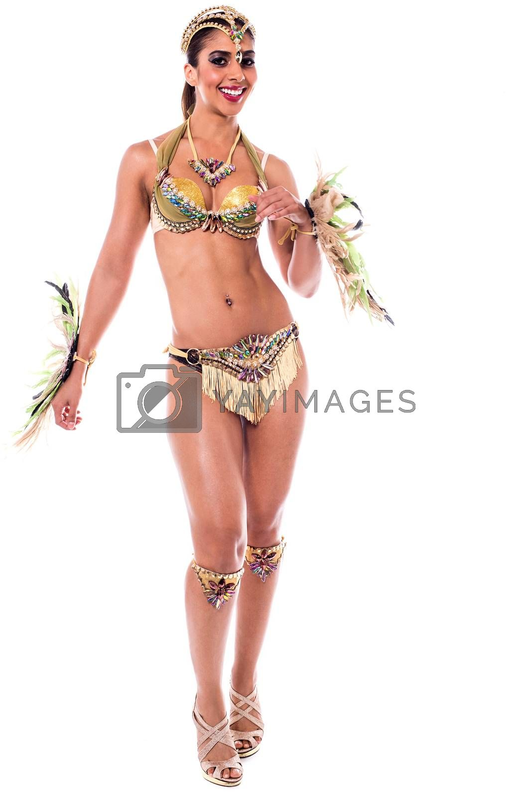 Beautiful carnival dancer in sexy costume over white