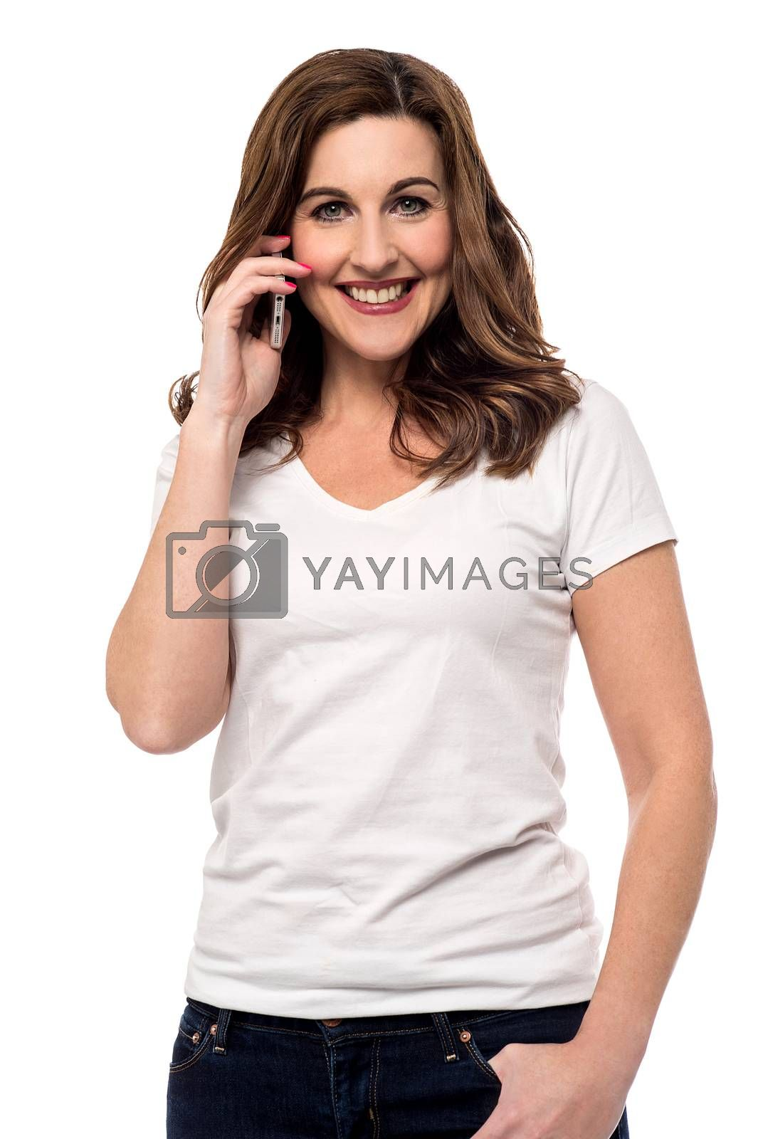 Smiling woman talking on her cell phone