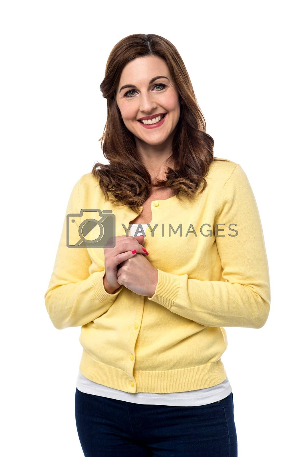Smiling mid woman welcoming with clasped hands