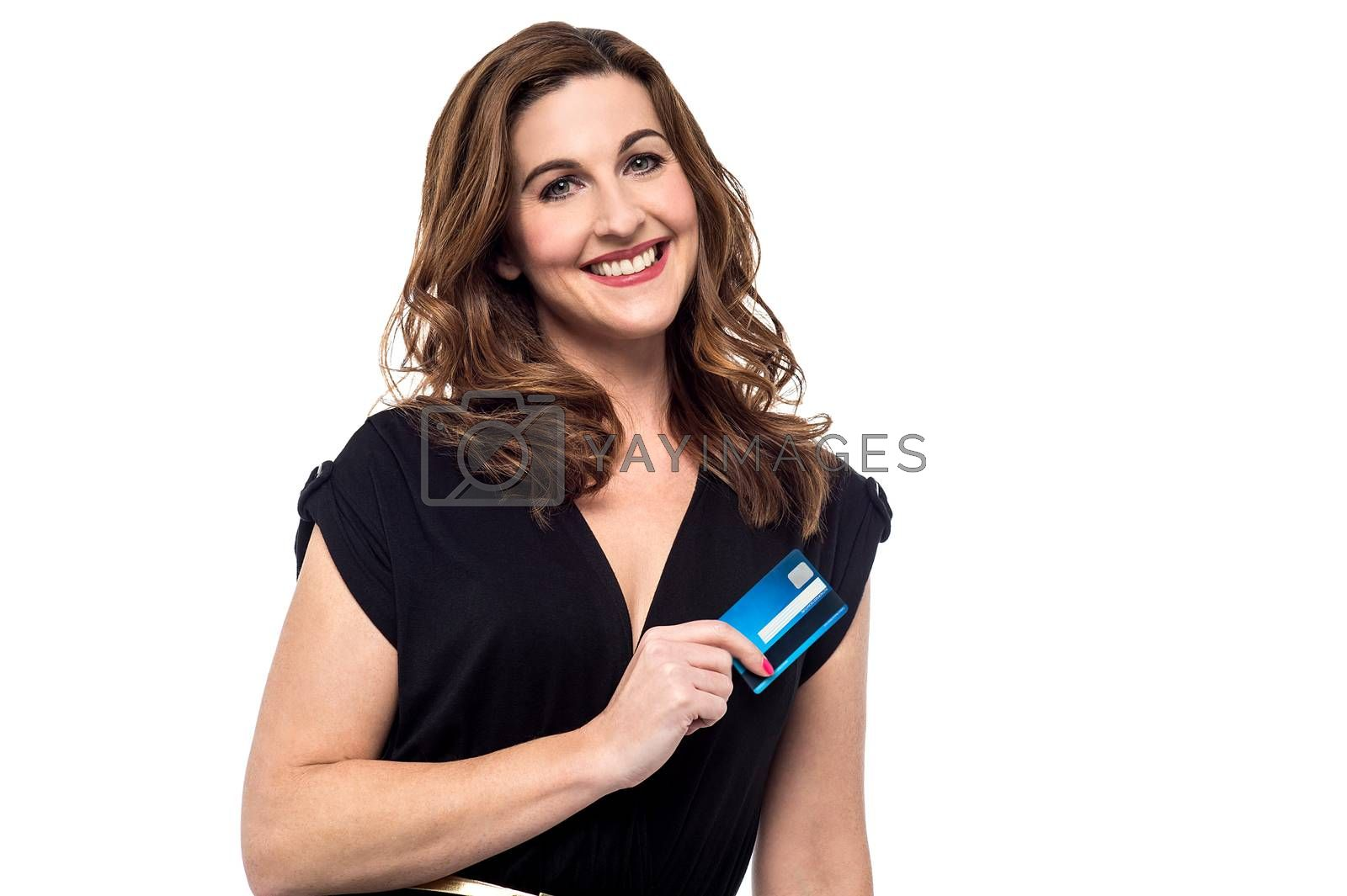 Happy mid woman showing her credit card