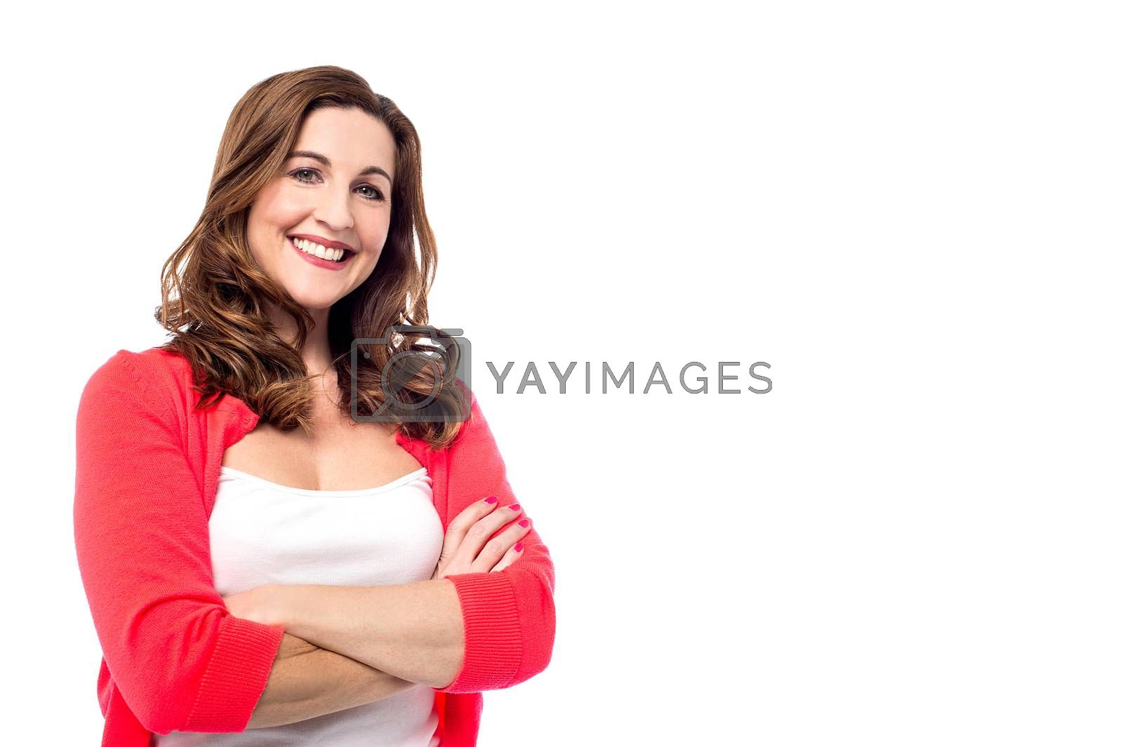 Smiling woman keeping her arms crossed over white
