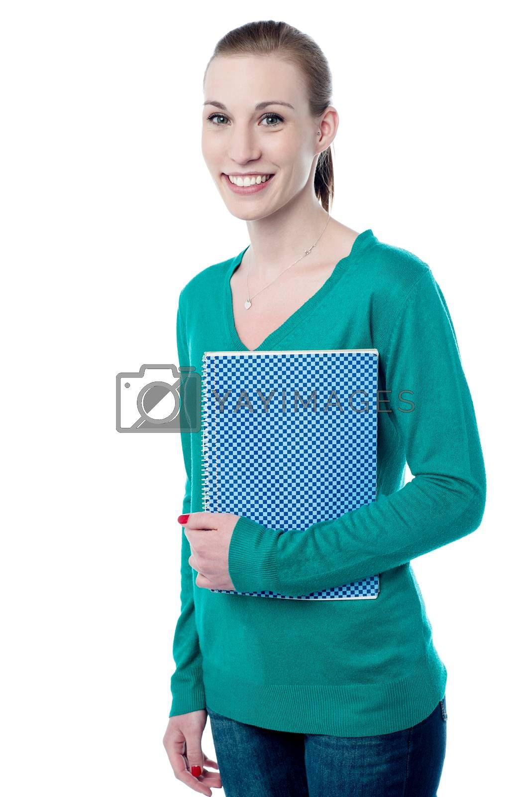 Young college student posing with notebook