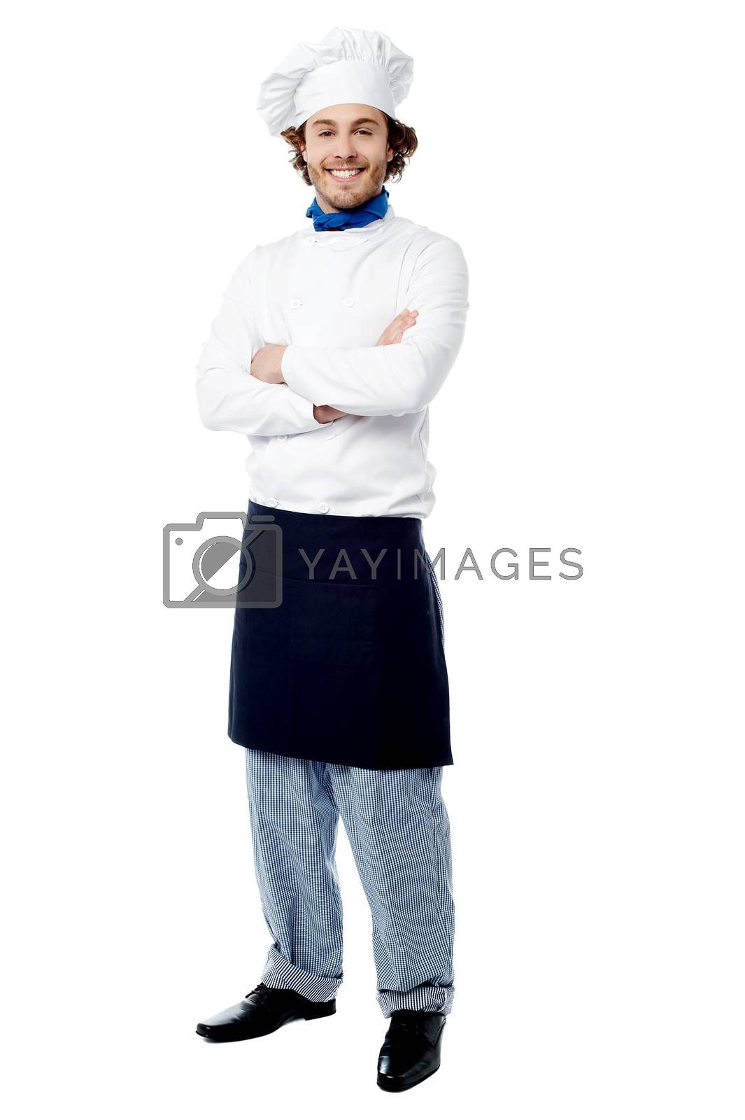 Confident happy male chef posing to camera