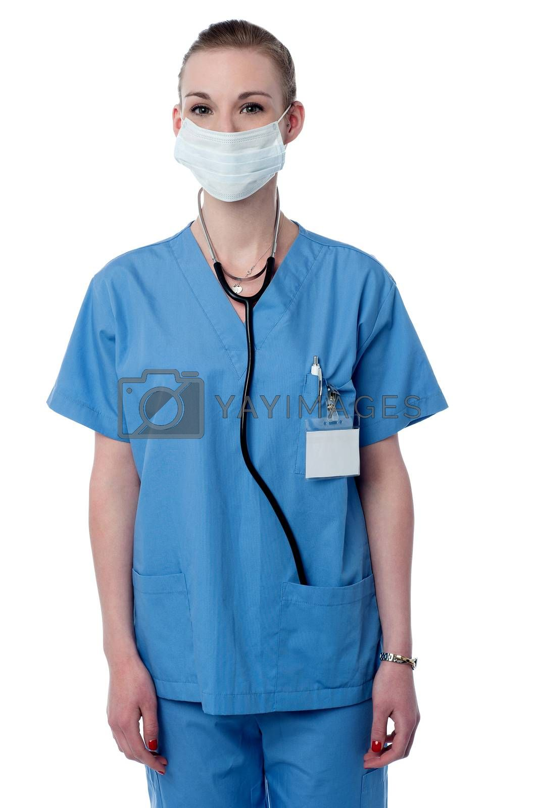 Female surgeon posing with face mask