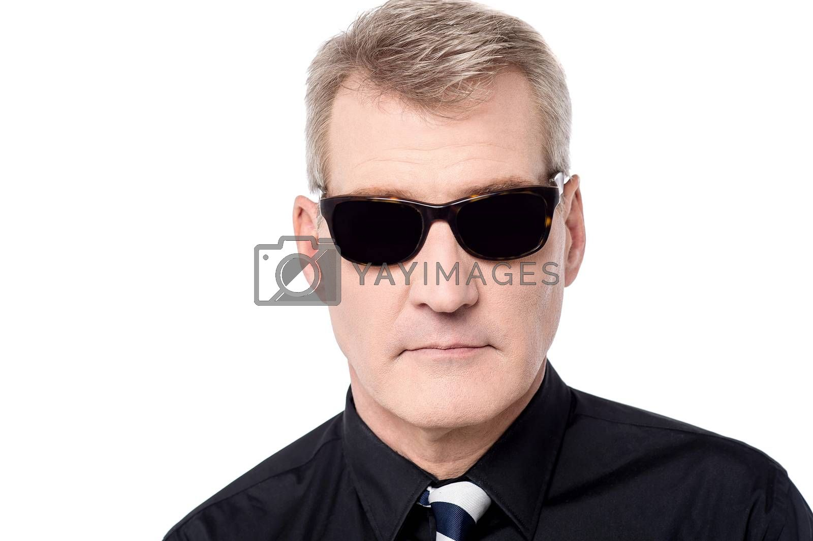 Handsome man posing to camera with sunglasses