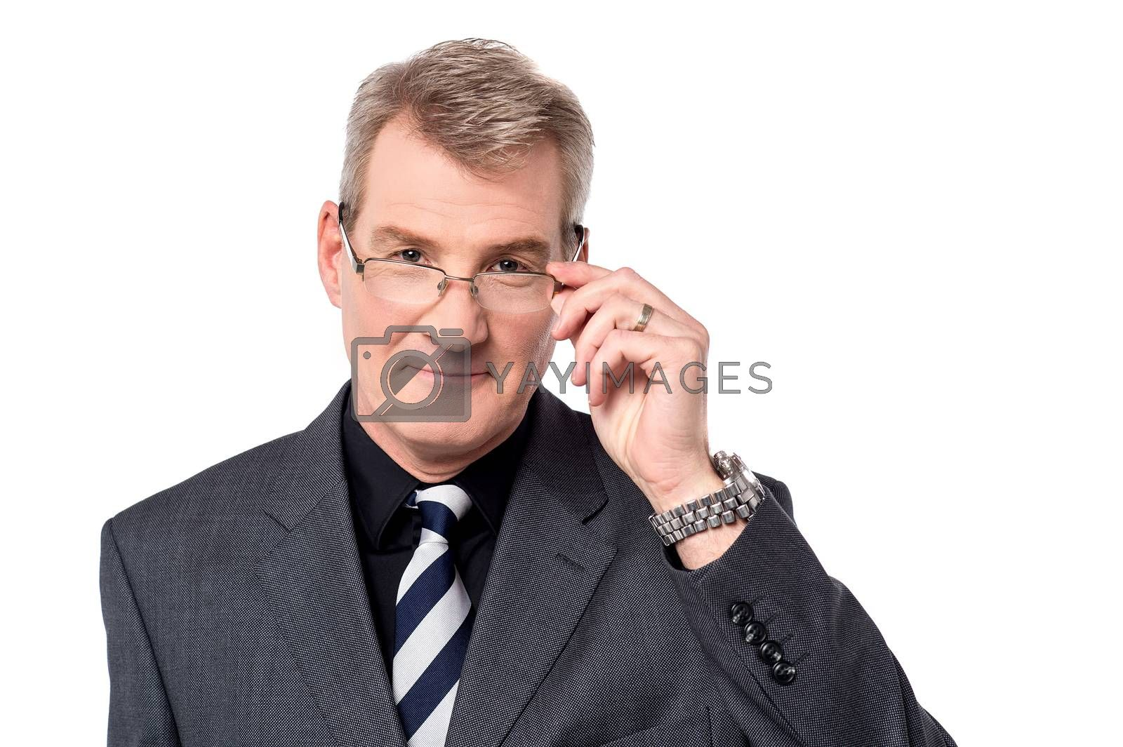 Business person adjusting his eyeglasses