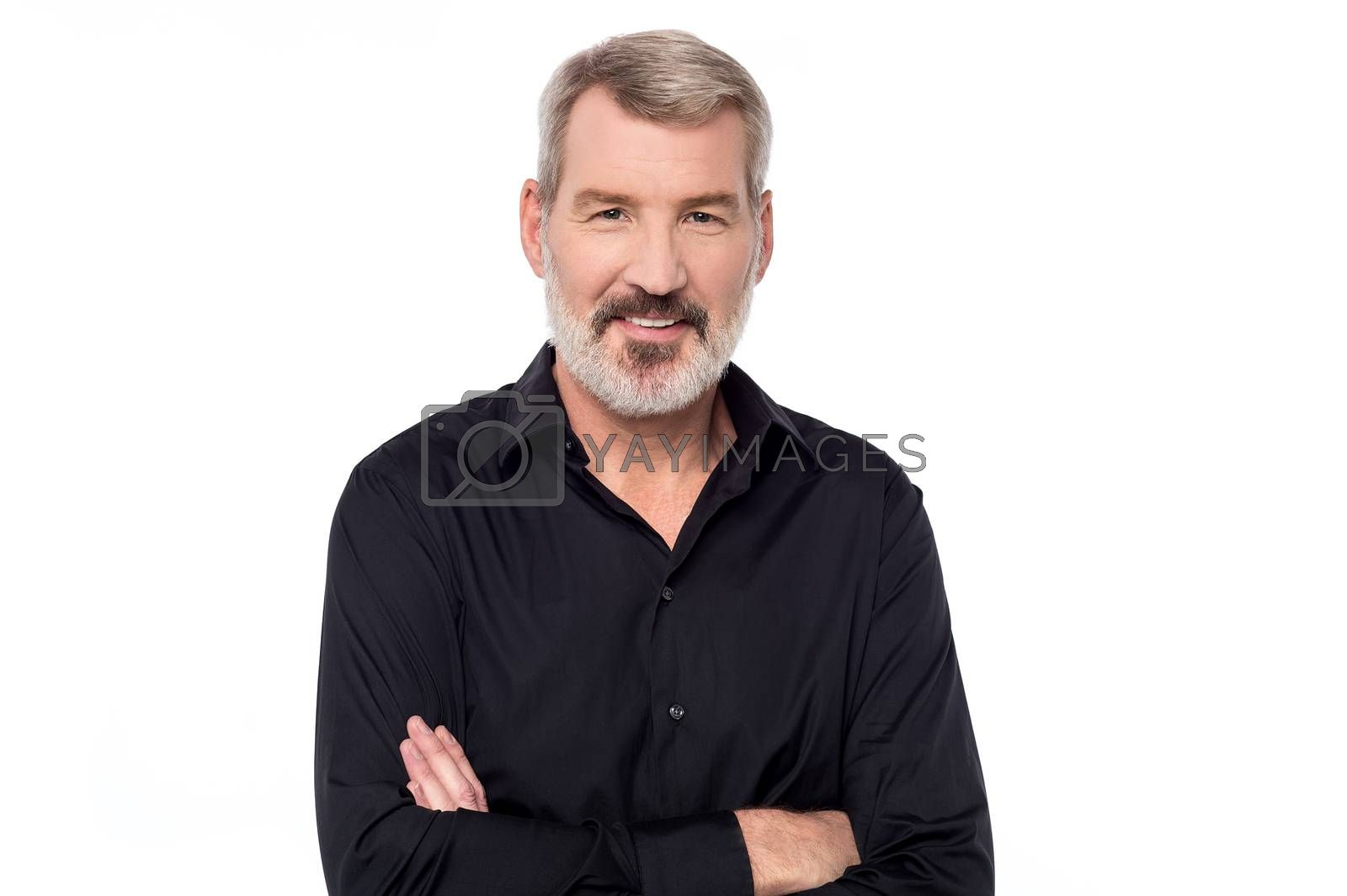 Handsome mature man posing with folded arms