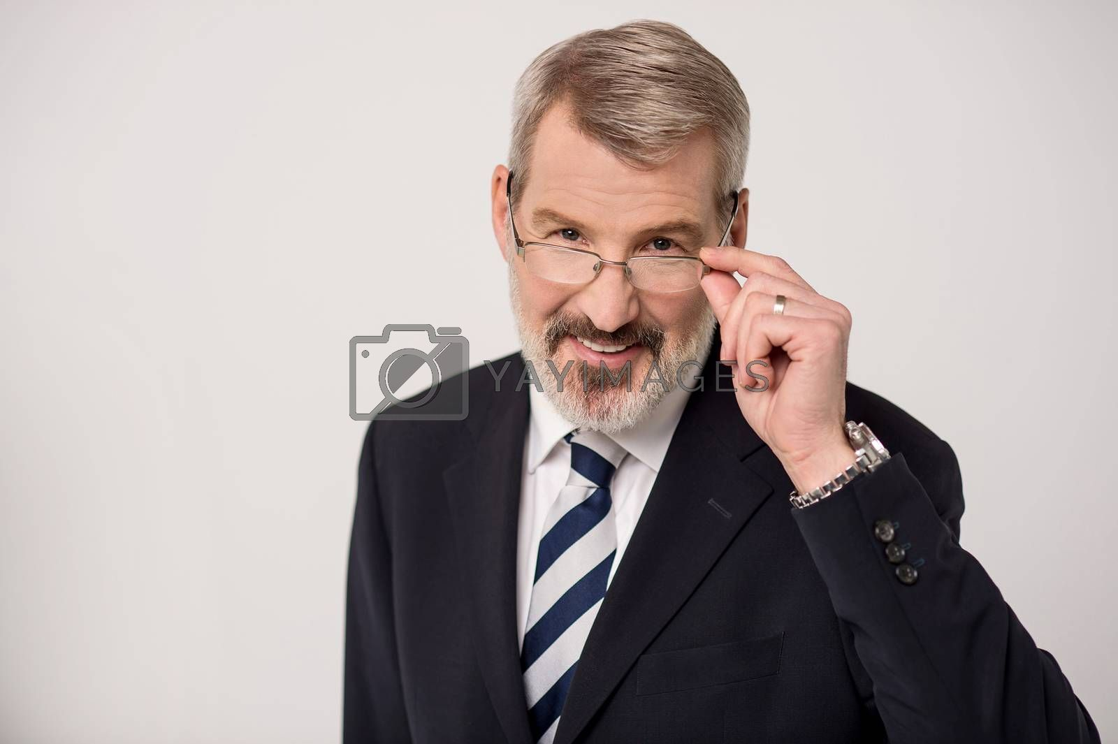 Senior businessman adjusting his glasses for clear view
