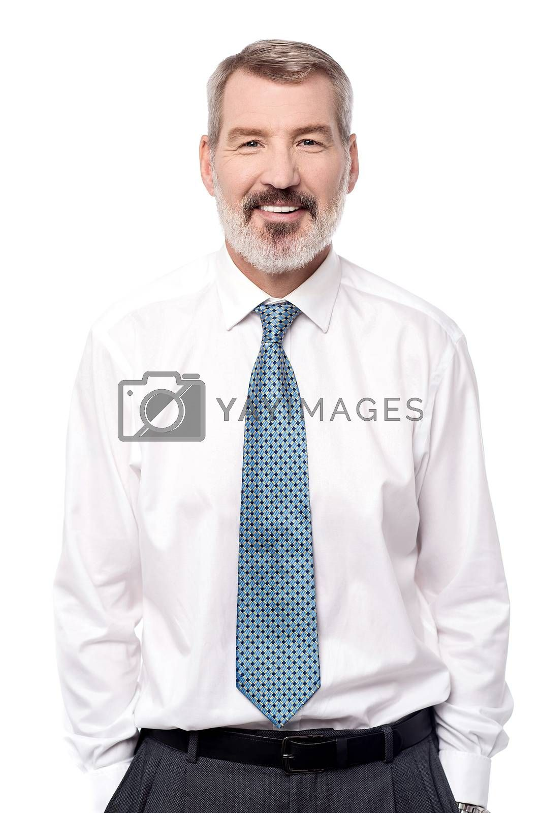 Smiling corporate male with hands in pockets
