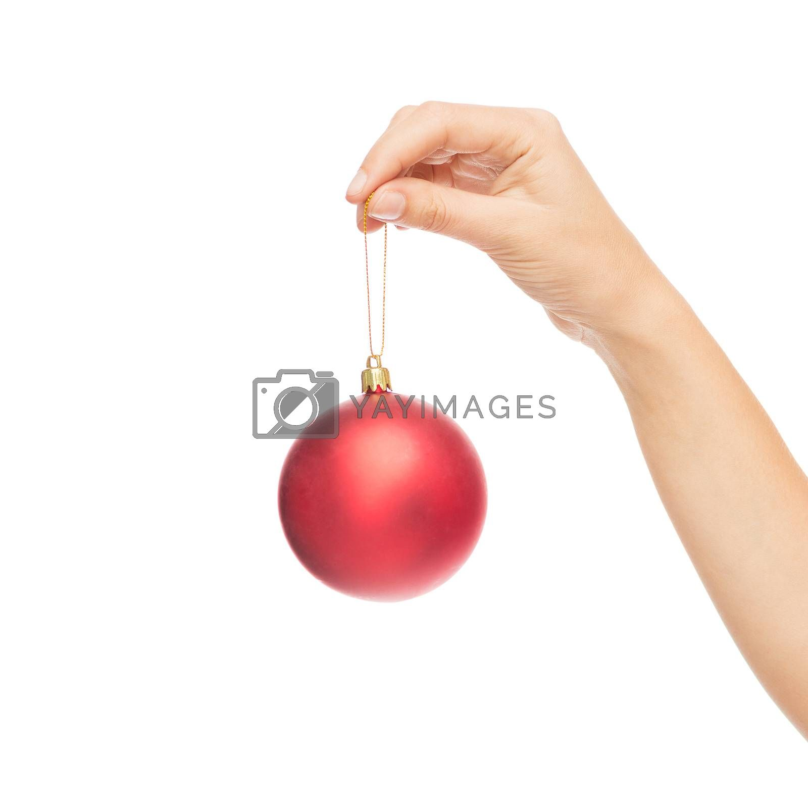 christmas, decoration, holidays and people concept - close up of woman hand holding christmas ball