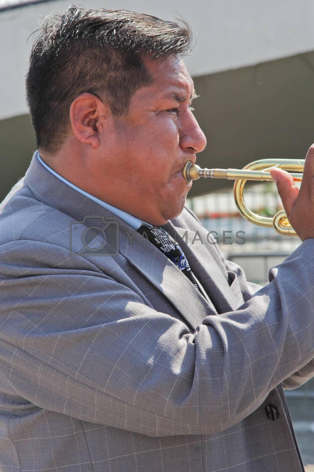 SAO PAULO, BRAZIL August 9 2015: An unidentified man with typical costumes playing a typical music instrument during the Morenada parade in Bolivian Independence Day celebration in Sao Paulo Brazil.