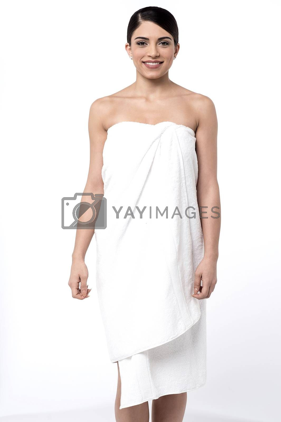 Pretty young woman covering herself with towel