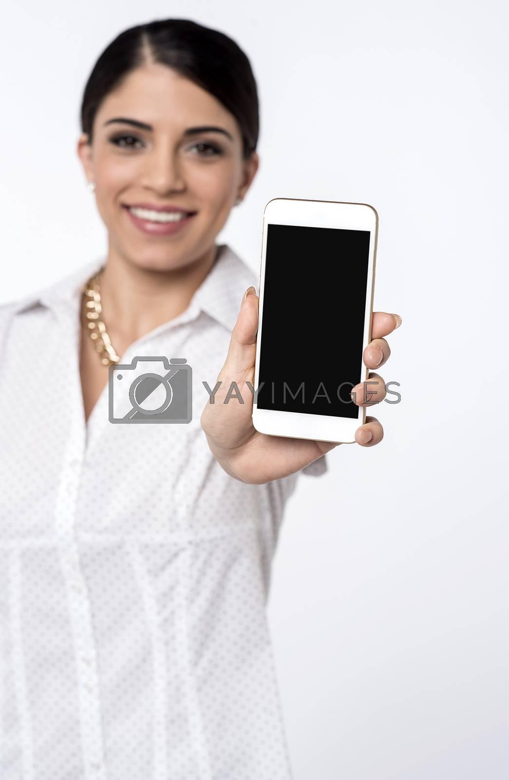 Pretty female representative showing new mobile phone