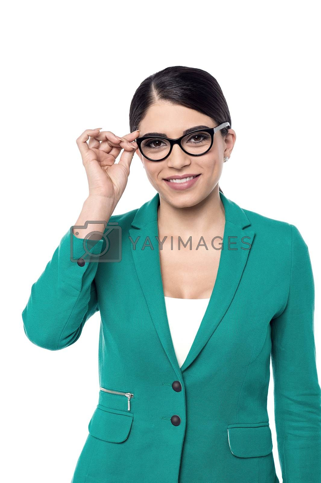 Image of a business woman adjusting her eye glasses