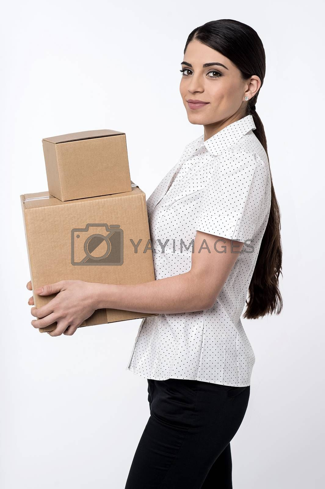 Sideways of pretty woman carrying carton boxes
