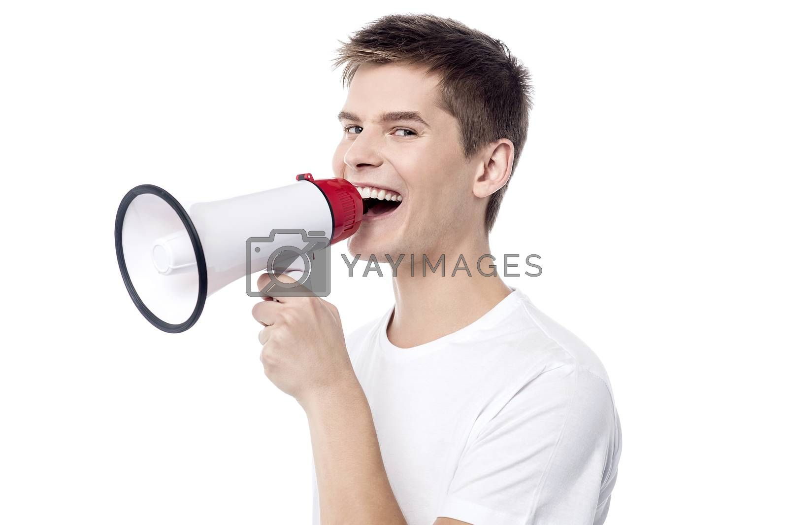 Young man proclaiming into megaphone