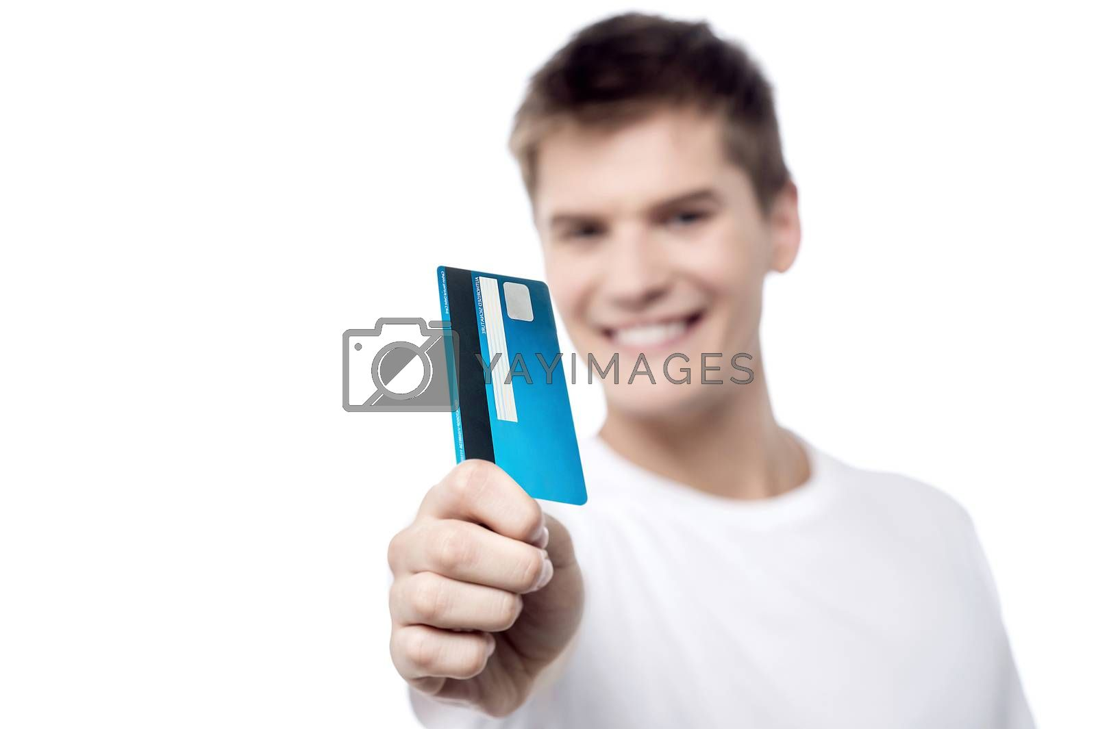 Male showing his credit card, focus on card.