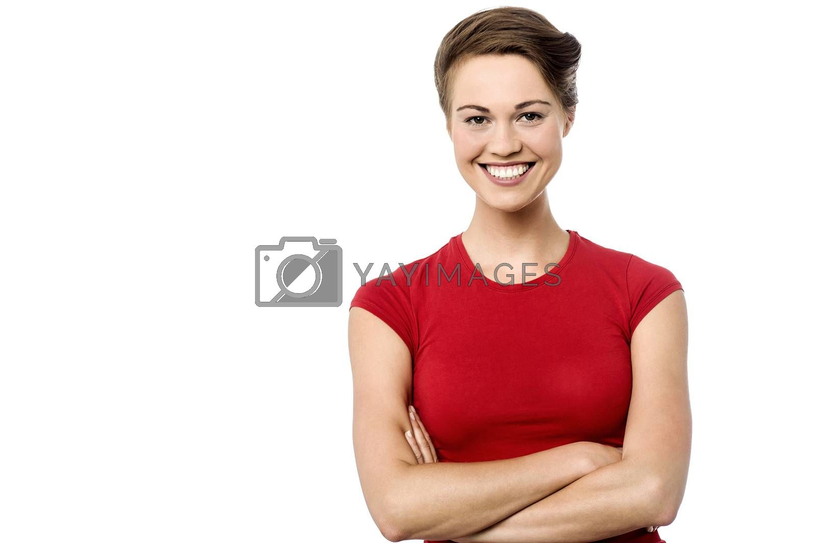 Happy young woman posing with folded arms