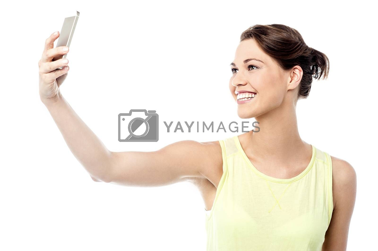 Cheerful woman taking a picture of herself