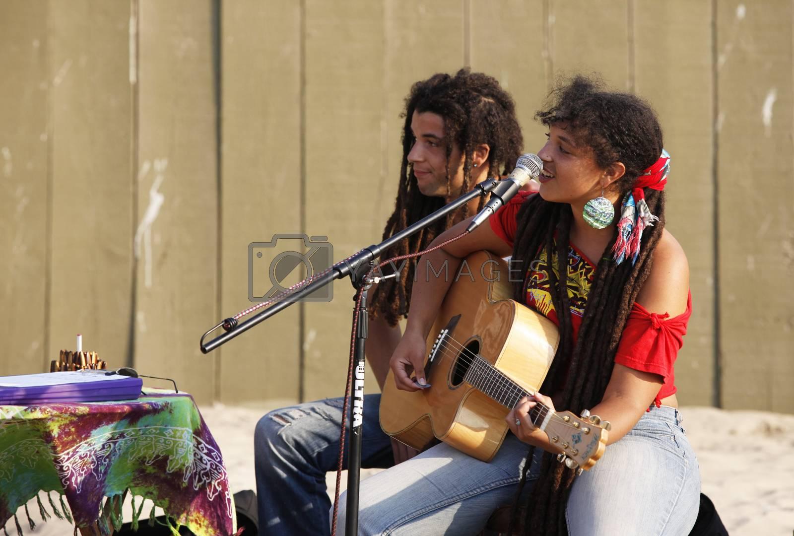 Santa Monica, CA, USA - September 18, 2011: Naia Kete with his musicians use the Santa Monica beach as the backdrop to to present their song