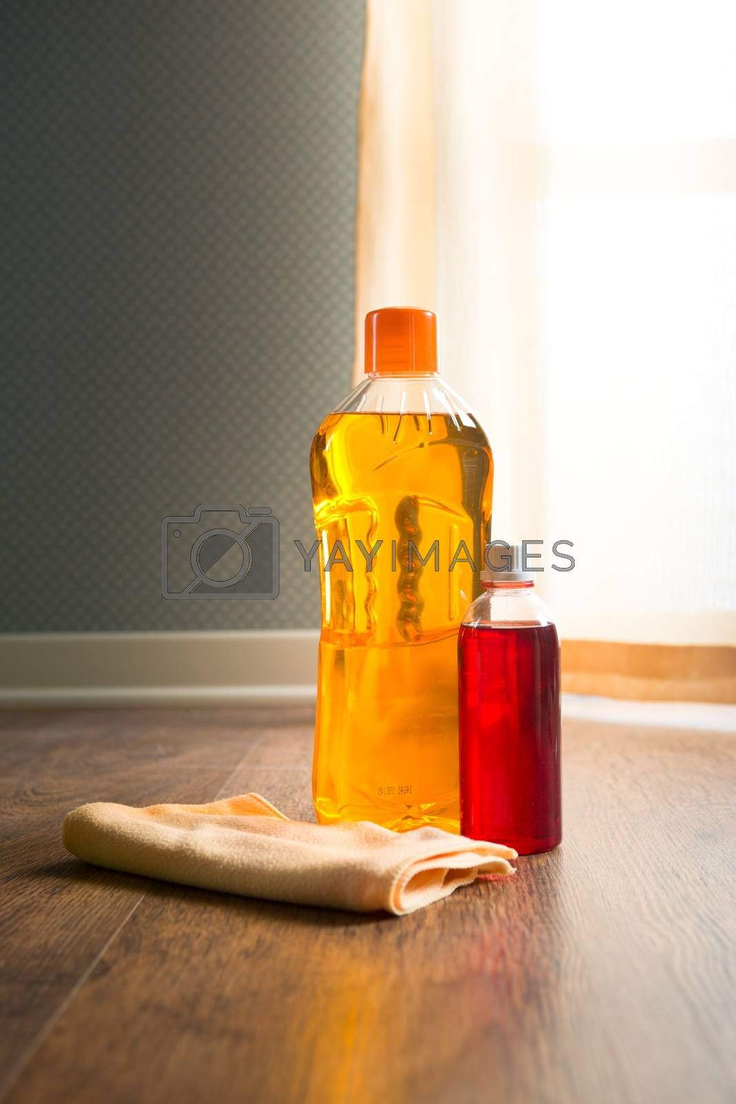 Royalty free image of Hardwood floor cleaners by stokkete