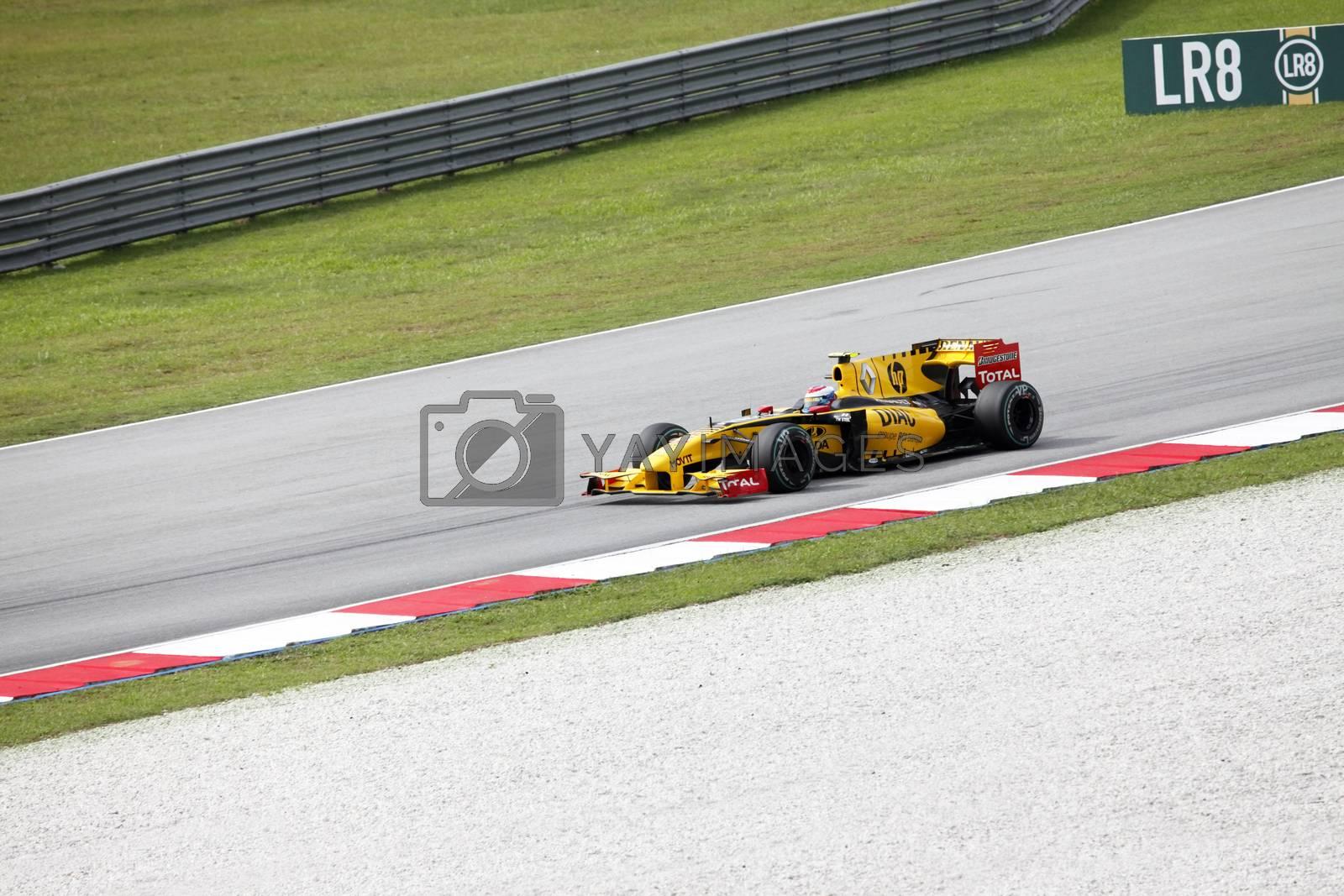 SEPANG, MALAYSIA - APRIL 4 : Renault F1 driver Vitaly Petrov of Russia drives during Petronas Malaysian Grand Prix at Sepang F1 circuit April 4, 2010 in Sepang