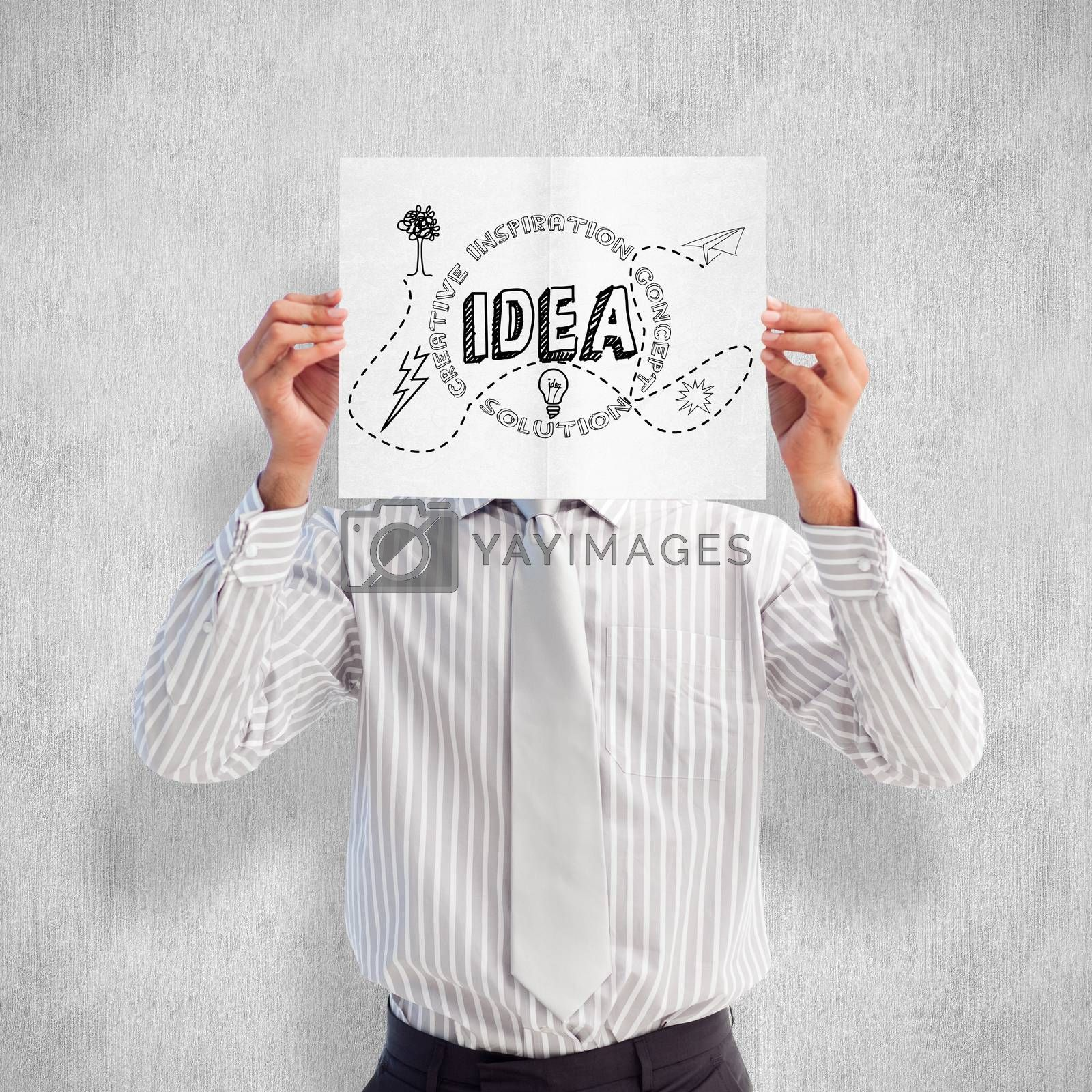 Businessman holding a white card covering his face against white and grey background