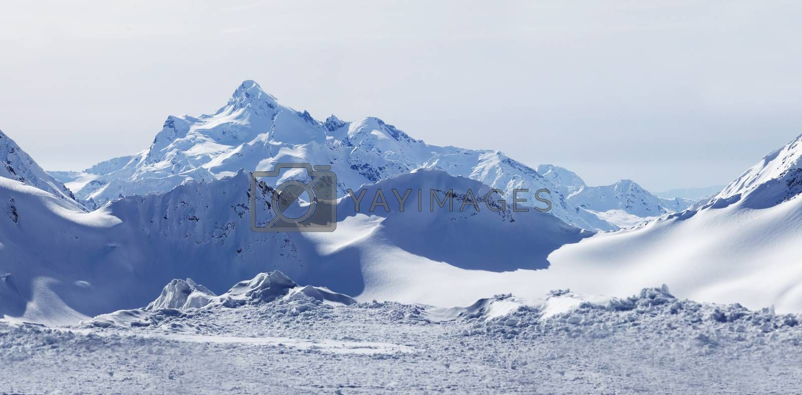 Russia. Caucasus. View on Elbrus Mount - the highest point of Europe from Cheget Mount. Panorama the review from 4 shots