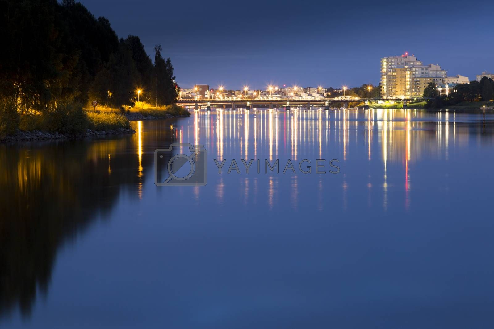 Downtown Umeå, Sweden at Night overlooking the river.