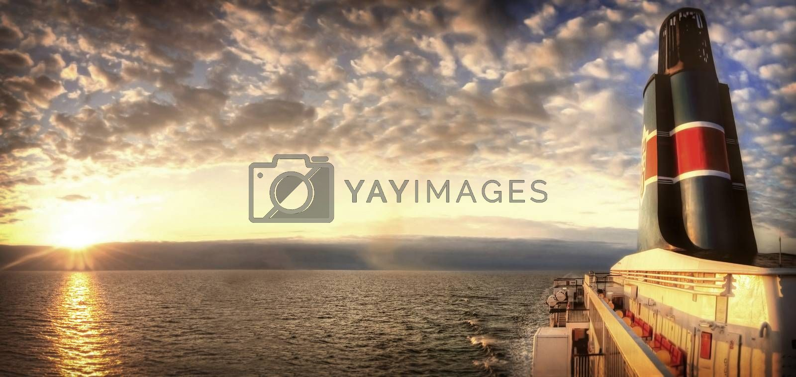 Travel conceptual image. Sunset over the sea visible from the ferry.