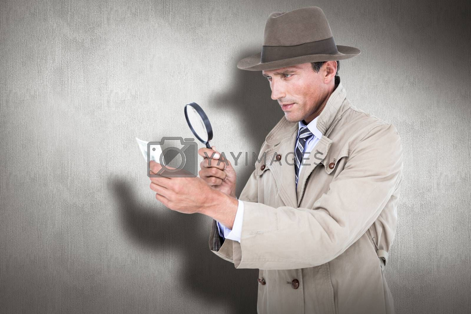 Spy looking through magnifier against white and grey background