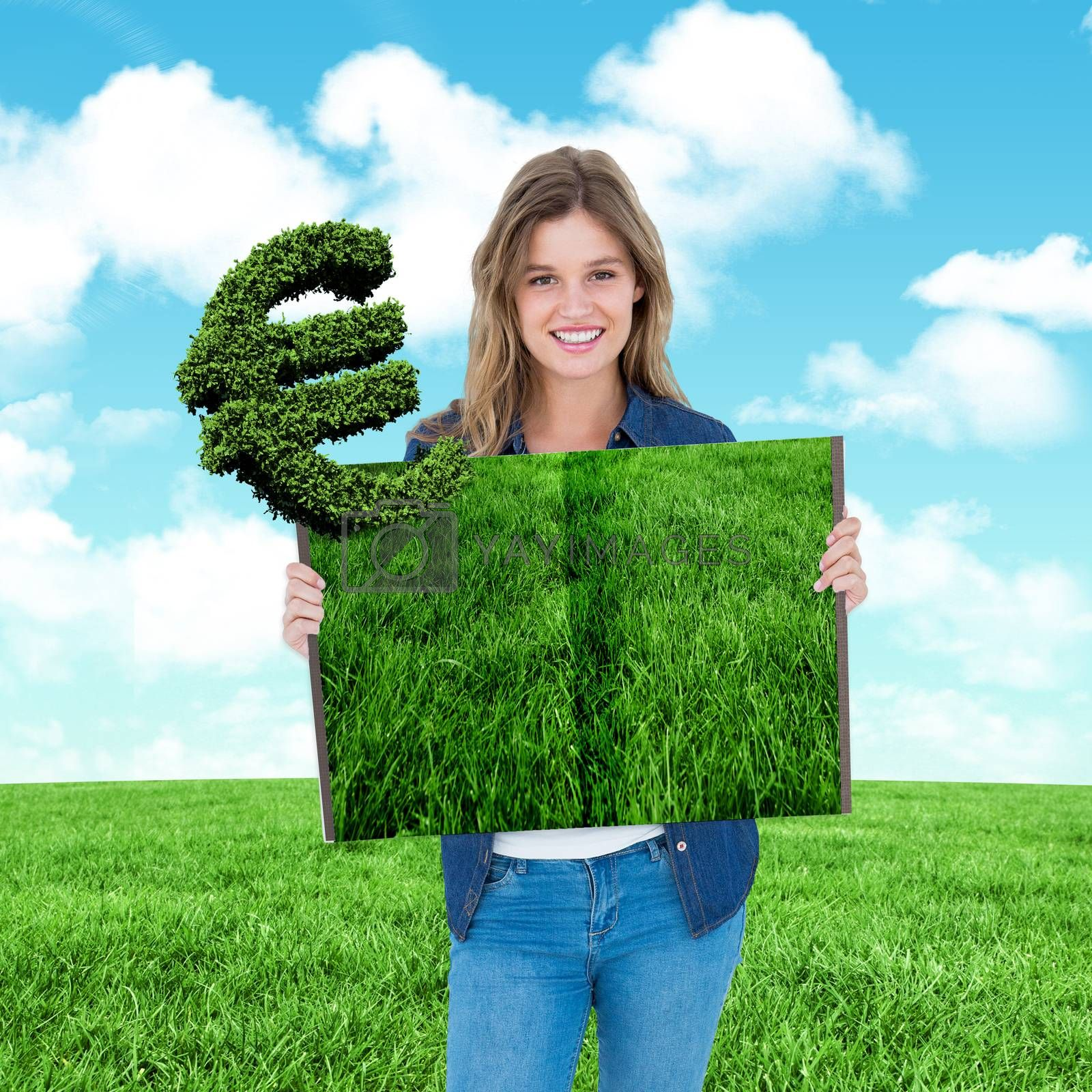 Woman holding lawn book against blue sky over green field