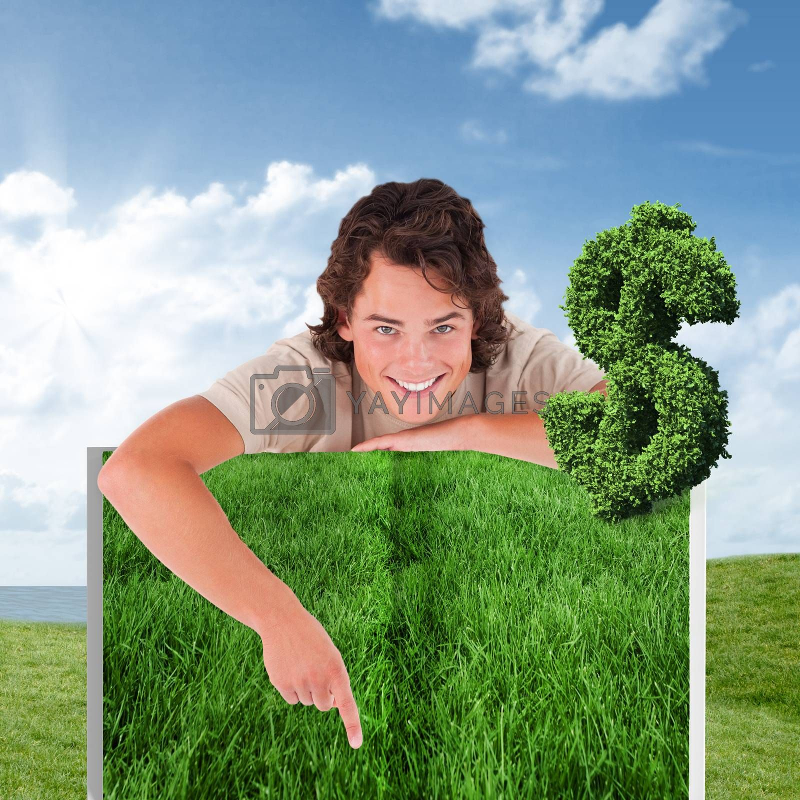 Person pointing against green field under blue sky