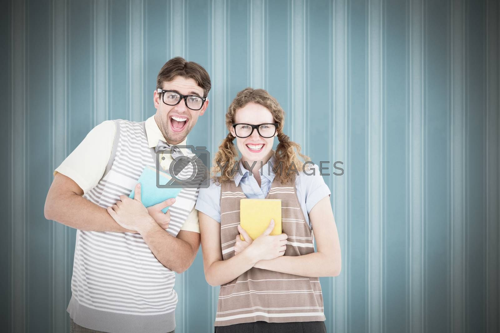 geeky hipster couple holding books and smiling at camera  against background