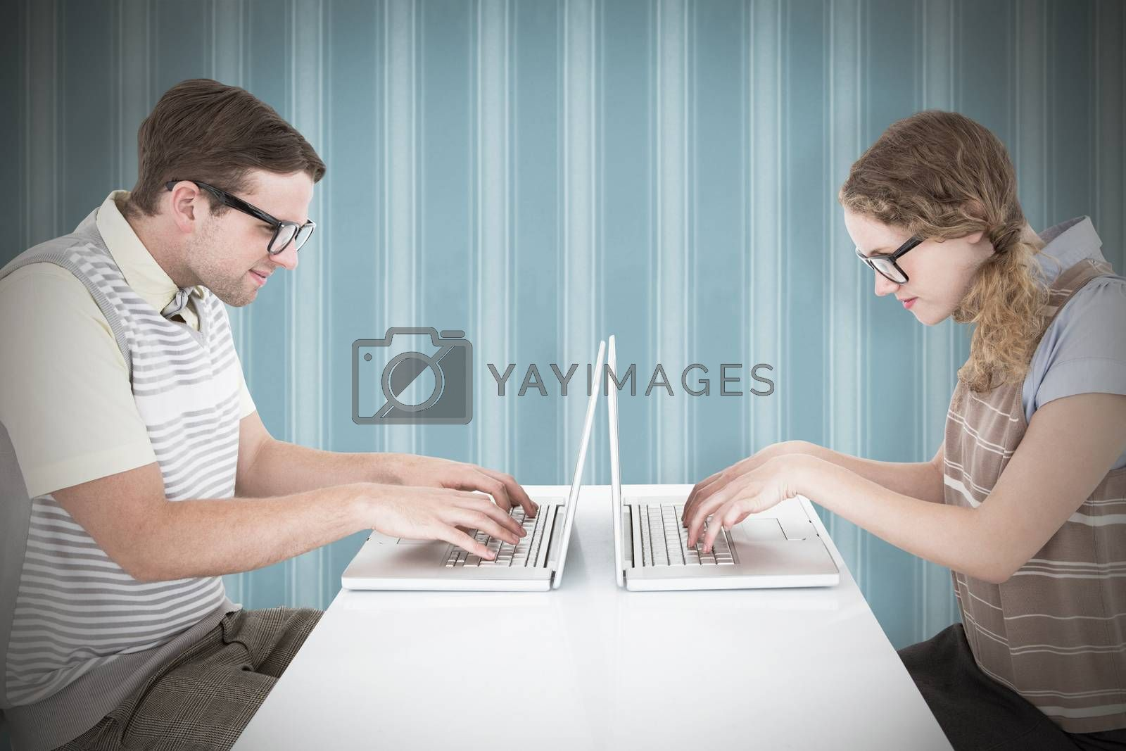 Geeky hipster couple using laptop against background