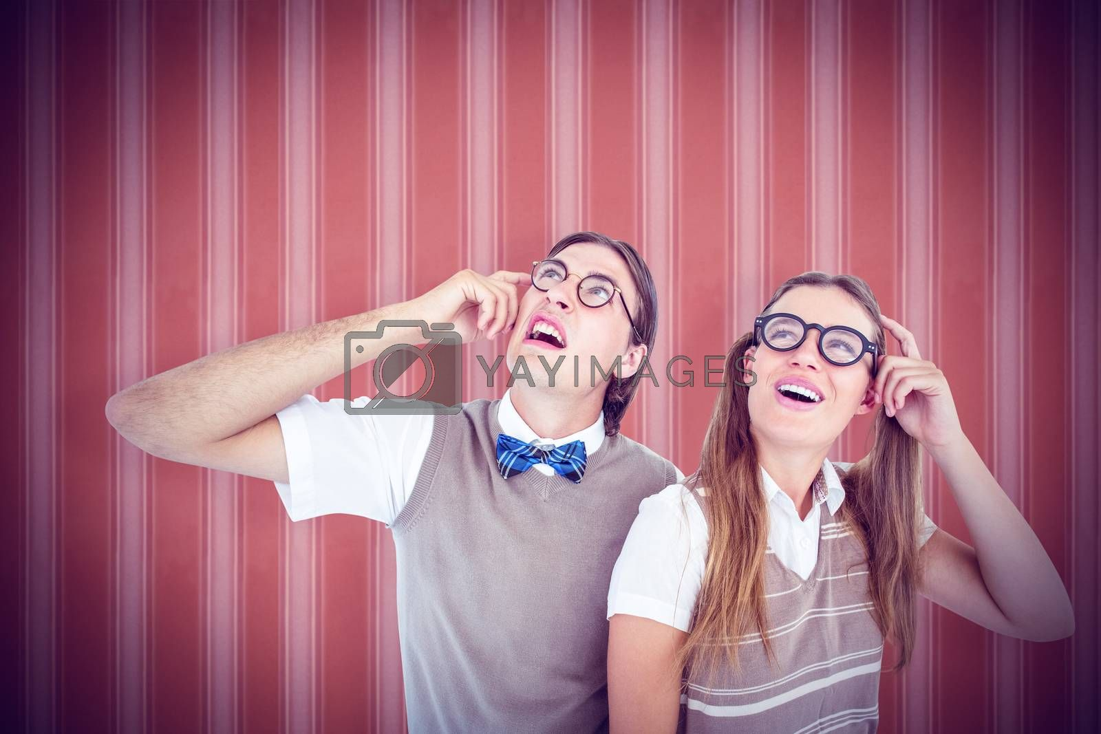Geeky hipsters looking confused  against background