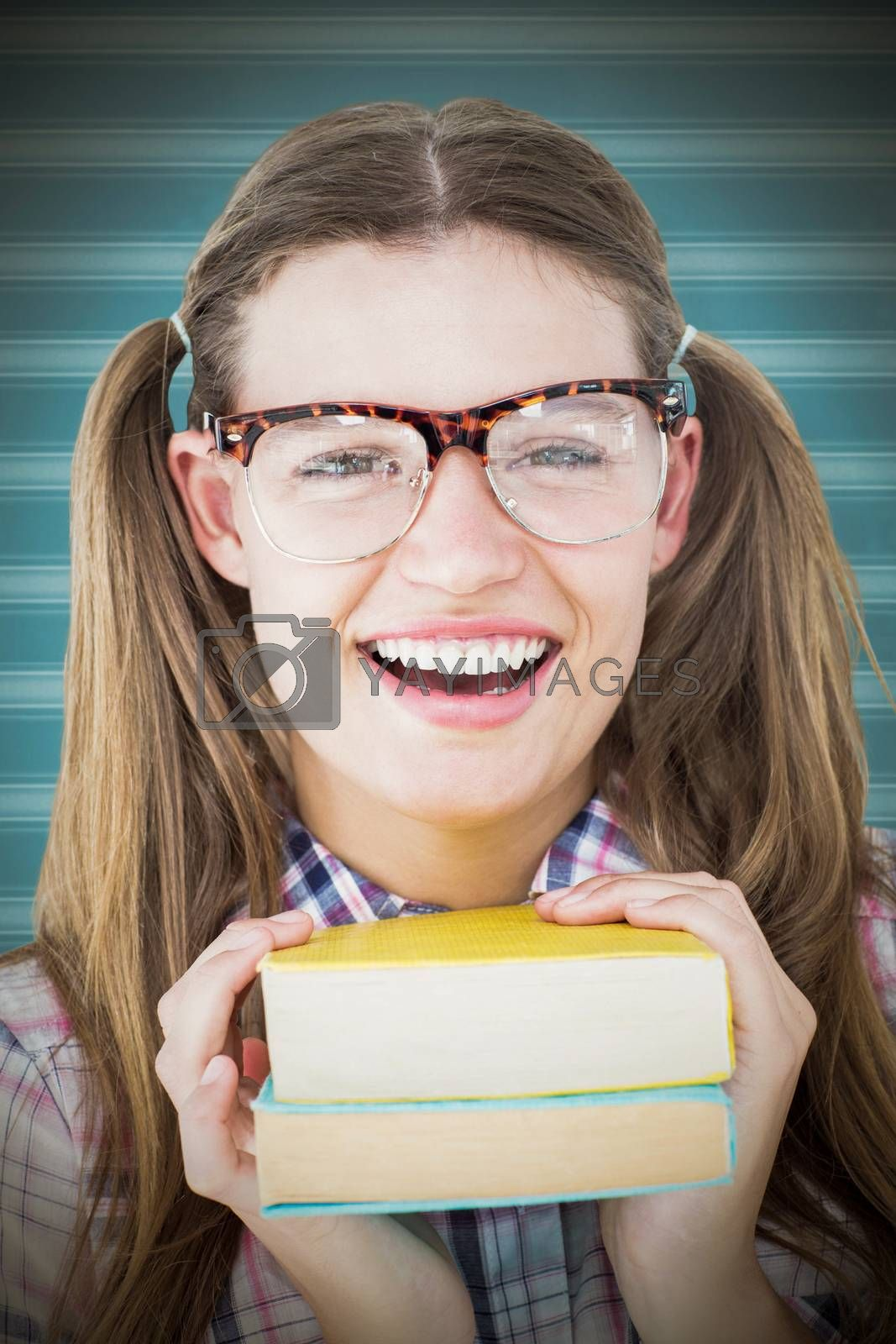Geeky hipster smiling at camera against background