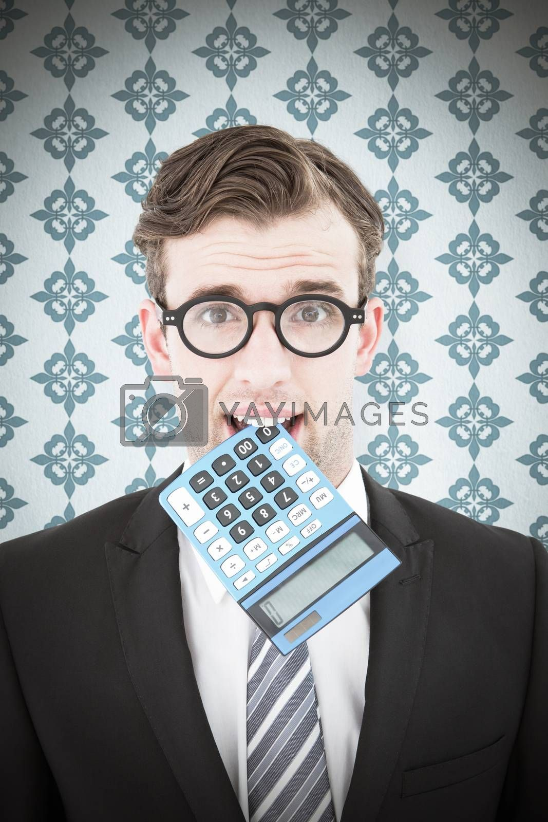 Geeky businessman biting calculator against blue background