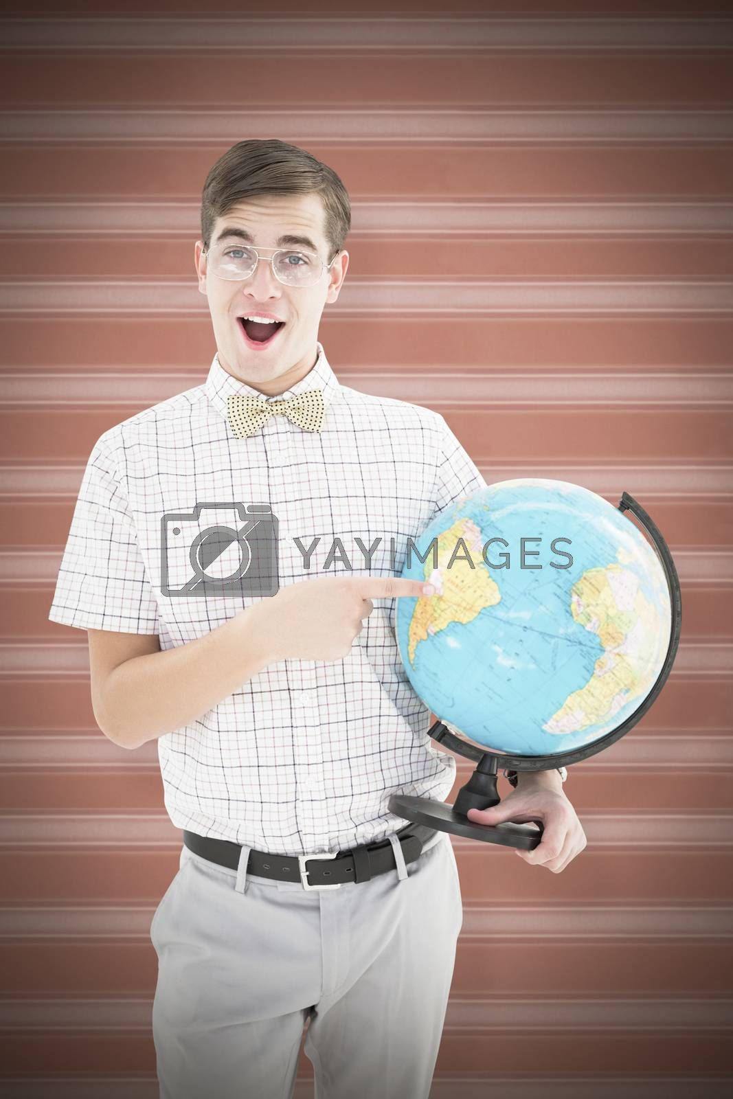 Geeky hipster holding a globe smiling at camera against background