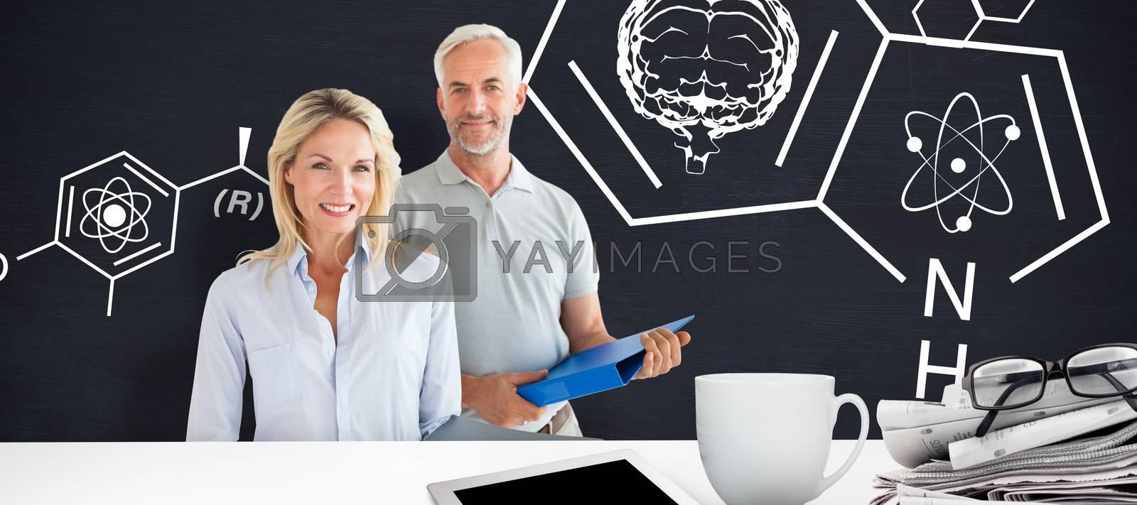 Mature students smiling against blackboard