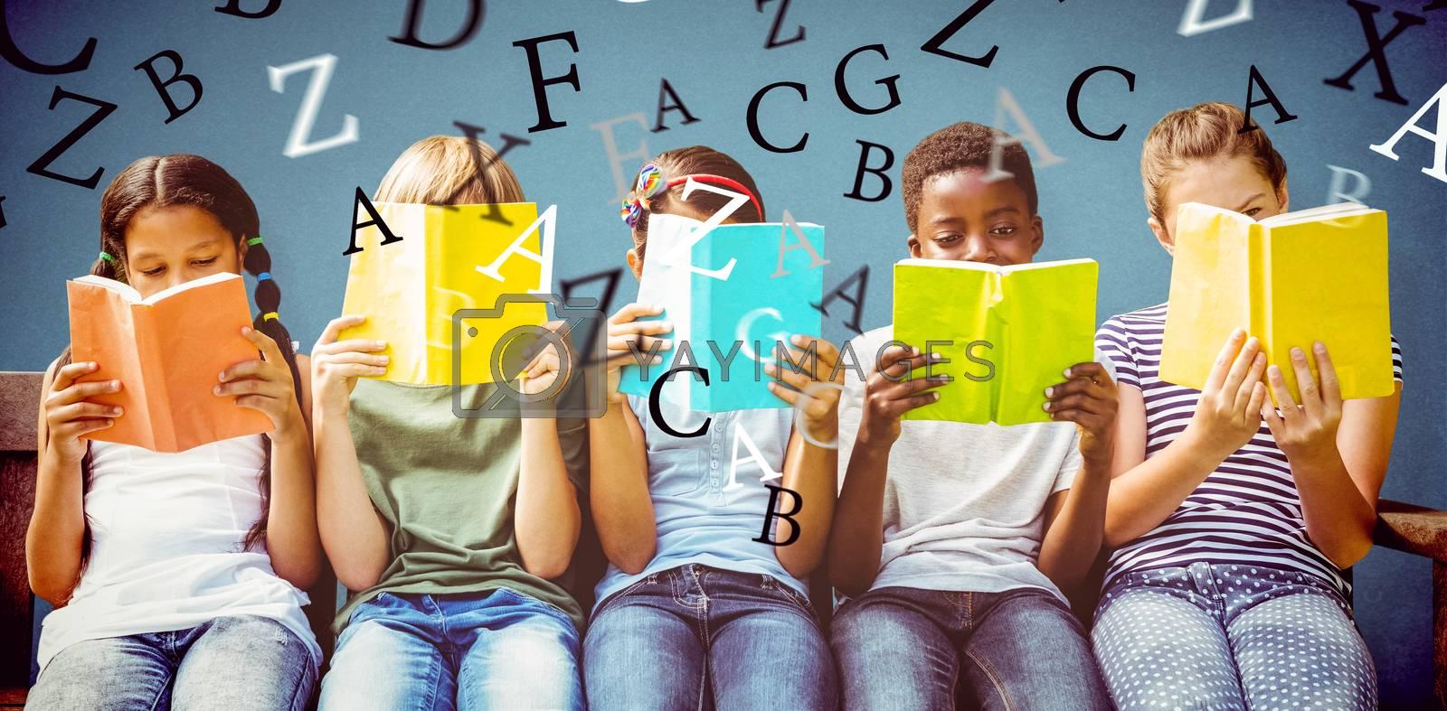 Children reading books at park against blue background