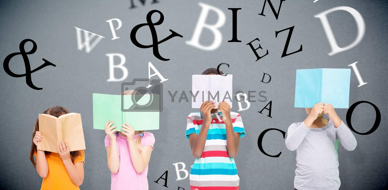 Elementary pupils reading against grey background