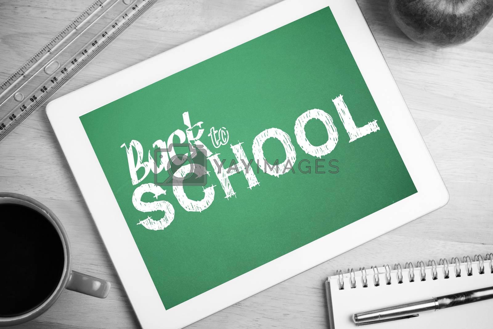 back to school against tablet on desk